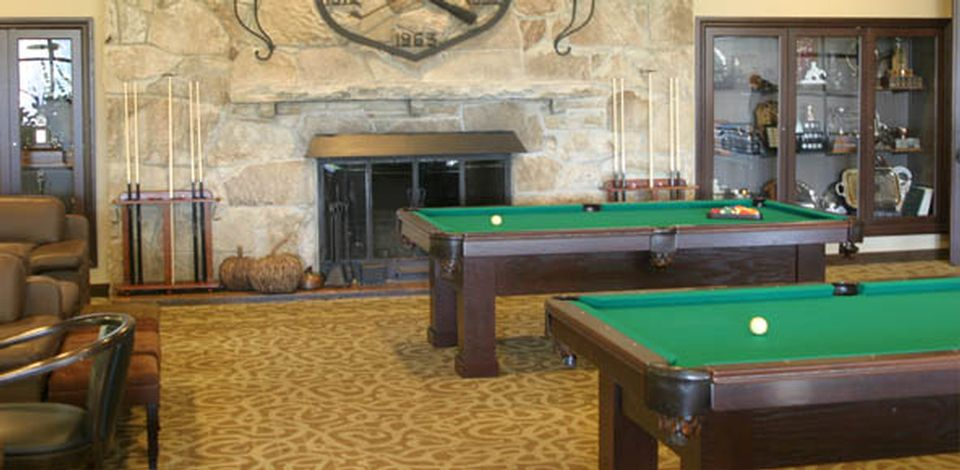 Custom built classic style pool table on rollers created by manufacturer designer Palason Billiards to help ease the moving of the pool table to different locations in a room or hall
