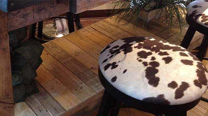 Amisco Connor industrial looking bar stool with faux cow hide seat