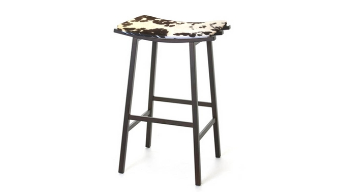 Industrial looking counter height bar stool with faux cow hide seat cover