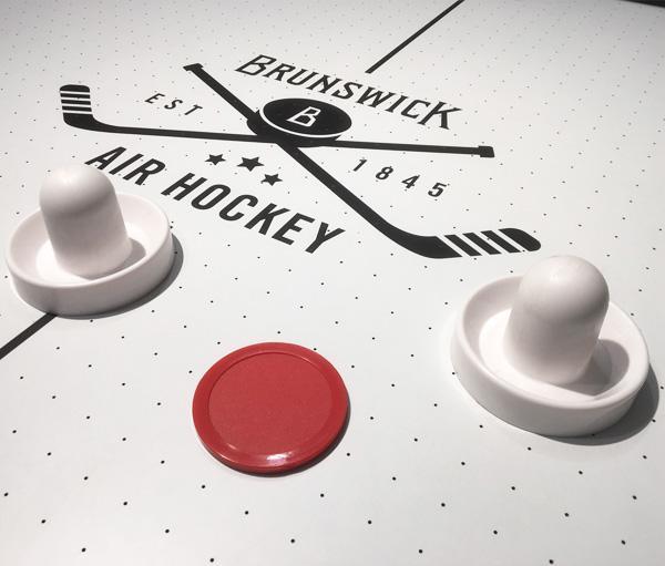 Official size 7 foot Brunswick barnwood air hockey table