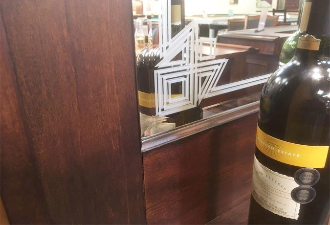 Wooden back bar mirror with bottle shelf